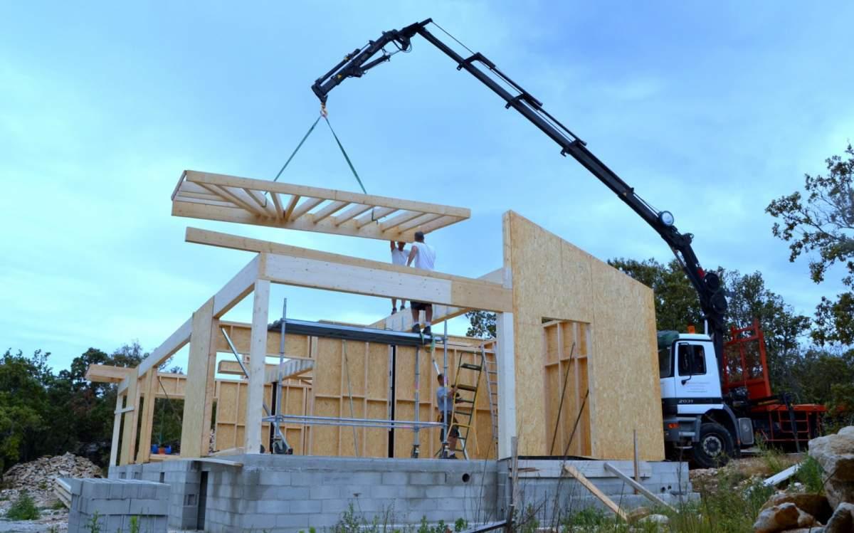 Artisan constructeur de maison ossature bois bois for Maison bois en u
