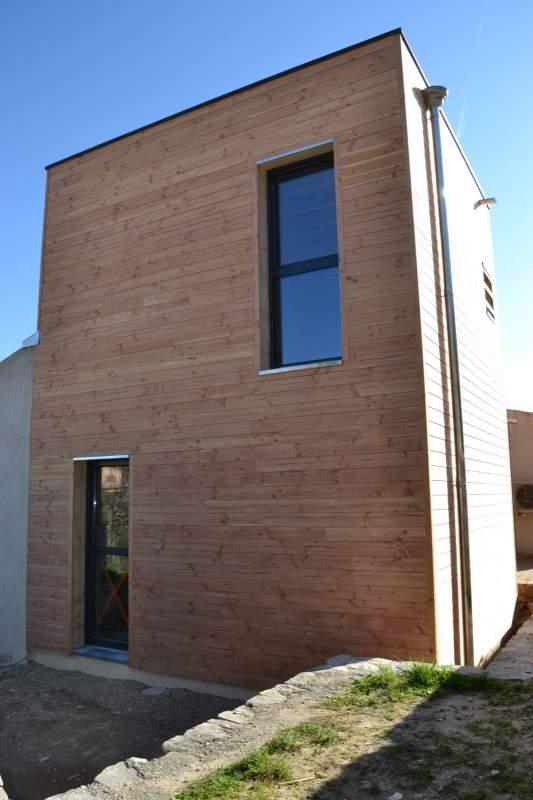 Agrandissement moderne en ossature bois avec toit terrasse for Agrandissement maison besoin architecte